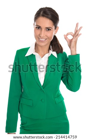 Isolated business woman in green making excellent gesture with fingers. - stock photo