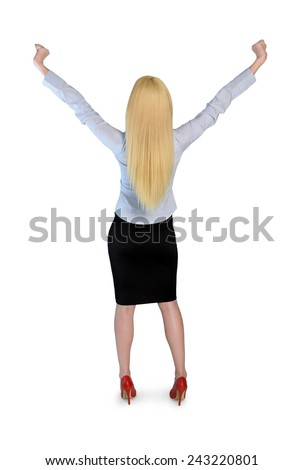 Isolated business woman winner with hands up - stock photo