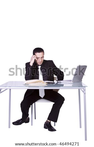 Isolated Businessman At His Desk Working - stock photo