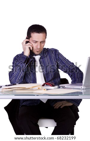 Isolated Businessman At His Desk Working While Talking on the Phone