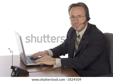 isolated businessman at the desk with headset