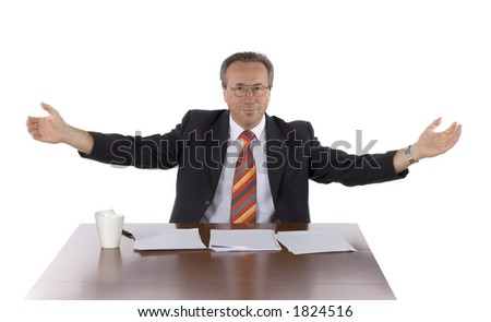 isolated businessman at the table welcomes - stock photo