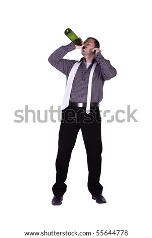 Isolated businessman celebrating with a bottle of drink while talking on the phone - stock photo