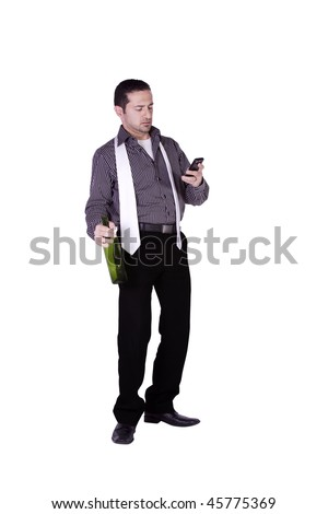 Isolated businessman celebrating with a bottle of drink while texting on his cell phone - stock photo