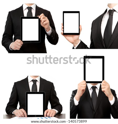 Isolated businessman in a suit holding a touch tablet computer - stock photo