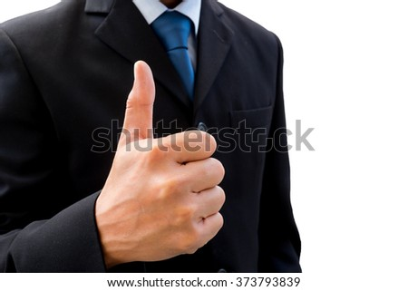 Isolated businessman in dark gray suit raising his thumb up represent business success, good job, ok, great and all good things.
