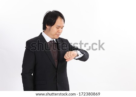 Isolated Businessman looking at his watch - stock photo
