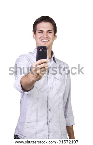 Isolated businessman sending a picture message on his cell phone - stock photo