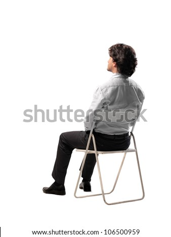 Isolated businessman sitting on a chair - stock photo