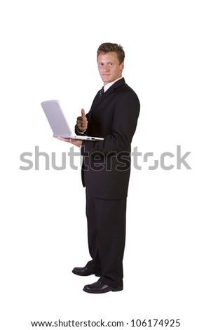 Isolated Businessman working on laptop and gesturing with thumbs up