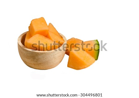 isolated cantaloupe on wooden bowl