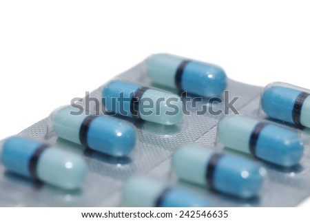 isolated capsule pills on white background - stock photo