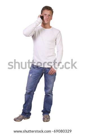 Isolated casual man with his hand in pocket talking on the phone