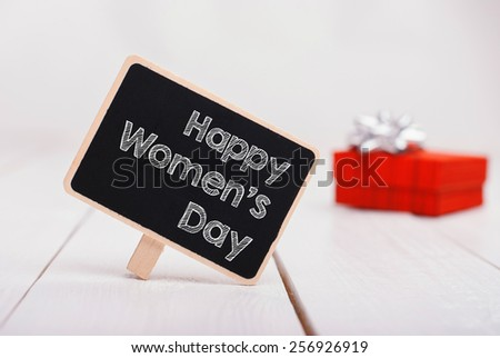 Isolated chalk board with inscription Happy womens Day and red gift on background. 8 march.Mothers Day - stock photo
