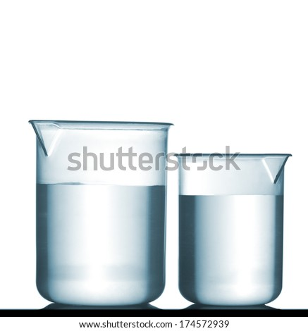 Isolated chemical plastic beakers on table with a small reflection and solution, studio shot - stock photo