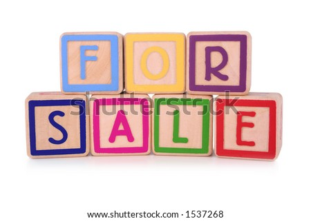 Isolated children's building blocks spelling the words for sale - stock photo