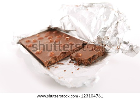 Isolated chocolate bar in the foil package - stock photo