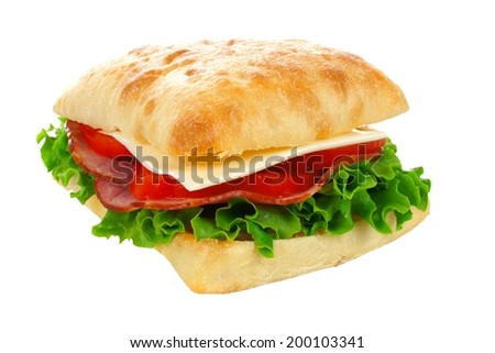 Isolated ciabatta sandwich with ham, tomato, lettuce and cheese
