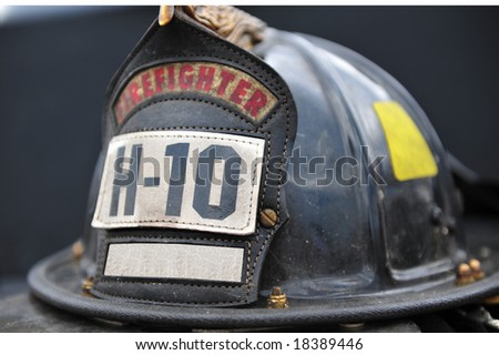 Isolated close up of old firefighters hat - stock photo