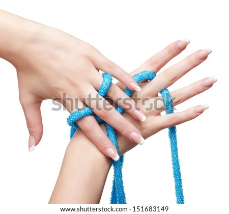 isolated close up shot of young woman's beautiful hands with beads - stock photo