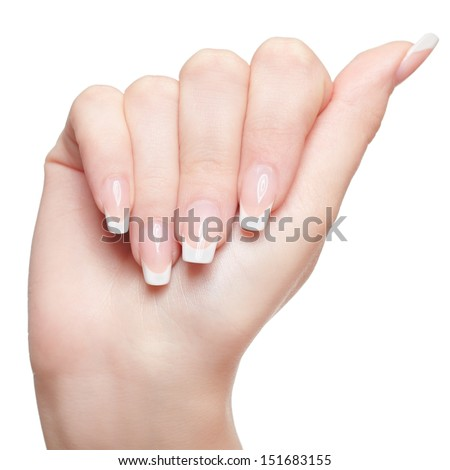 isolated close-up shot of young woman's healthy hand with thumb up - stock photo
