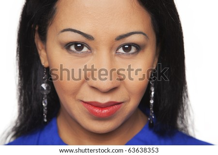 Isolated close up studio headshot of a Latina woman looking directly at the camera. - stock photo