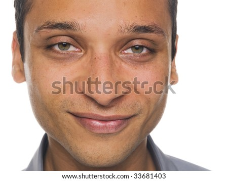 Isolated close up studio shot of a businessman's smiling face - stock photo