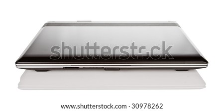isolated closed black laptop with reflection - stock photo