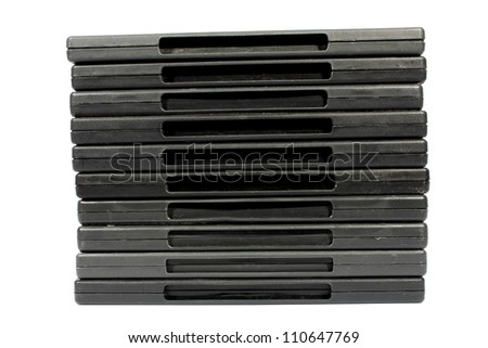 Isolated closeup of black plastic dvd safety covers. - stock photo