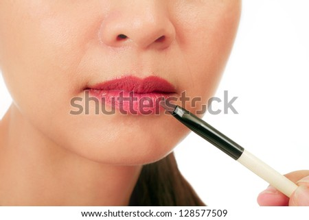 Isolated closeup on the lips of an asian middle age woman - stock photo