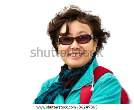 Isolated closeup portrait of a senior asian lady in Hukou Waterfall, Yellow River, China - stock photo