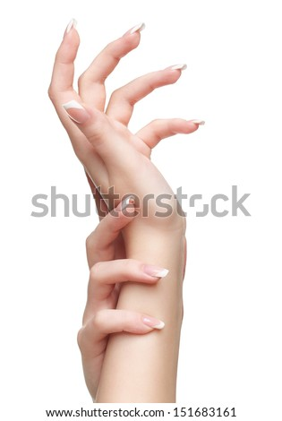 isolated closeup shot of young woman's healthy hands with manicure