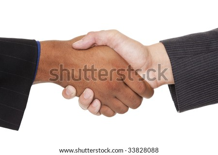 Isolated closeup studio shot of two businessmen shaking hands