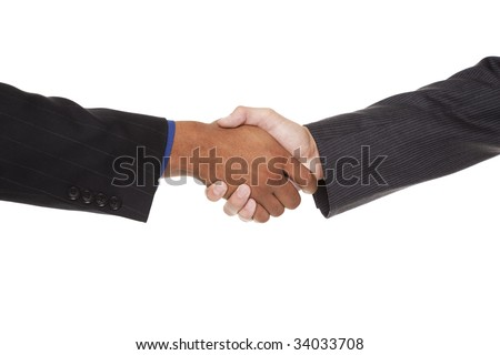 Isolated closeup studio shot of two businessmen shaking hands - stock photo