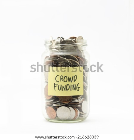 Isolated coins in jar with crowd funding label - financial concept - stock photo