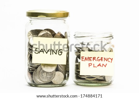 Isolated coins in jar with emergency plan and saving label - financial concept - stock photo