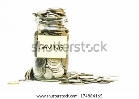 Isolated coins in jar with saving label - financial concept - stock photo