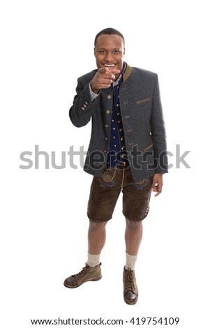 Isolated colored man in bavarian tradition clothes making thumbs up gesture isolated over white background.