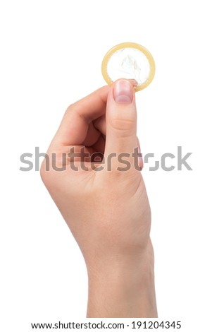 Isolated condom in hand