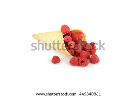 isolated cornet with fresh raspberries on white background