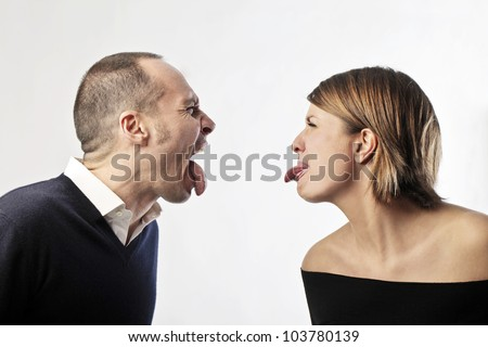 Isolated couple having fun of each other - stock photo