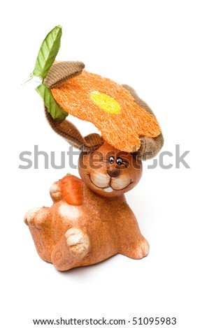 Isolated crazy clay rabbit holding flower and leaf with ears