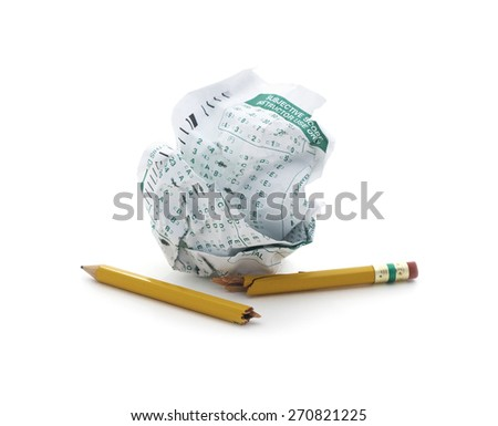 Isolated crumpled exam form with a broke pencil.
