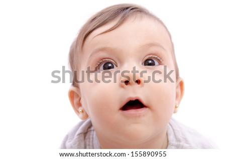Isolated cute baby with big black eyes looking at the view - stock photo