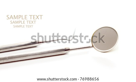 isolated dentist accesories, mirror - stock photo