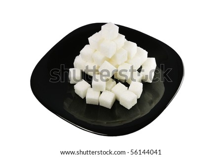 isolated destroyed white sugar pyramid on a plate - stock photo