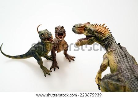 Isolated Dinosaurs model on white background - stock photo