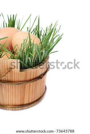 isolated eggs in the wooden basket