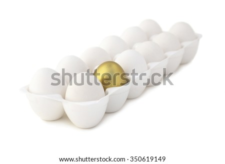 Isolated eggs with one gold egg. Selective focus. - stock photo