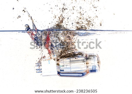 Isolated electronic vacuum tubes valve fall in water with big splash and white background - stock photo